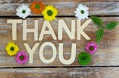 Thank you written with wooden letters and santini flowers