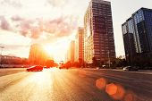 skyline,road,building in modern city during sunset