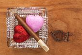Love And Harmful Habit In A Glass Ashtray