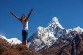 Young Woman Is Practicing Yoga Against Himalaya Mountains