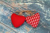 Two hearts on rustic wooden surface