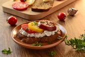 Sandwich with cream cheese, tomatoes