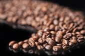 Roasted Coffee Beans Over Black Background