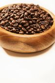 Authentic Wooden Bowl Filled With Coffee Beans. On White Background