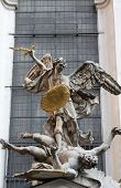 VIENNA, AUSTRIA - OCTOBER 10: Statue of Saint Michael with gold shield and sword in center of Vienna, Austria on October 10, 2014.
