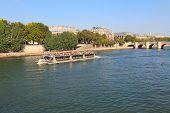 Tour Boat Near Pont Neuf And Ile De La Cite In Paris, France