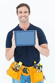 Portrait of happy carpenter holding digital tablet over white background