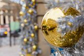 Golden shiny ball on Christmas street in Paris, France