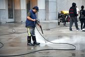 Man Using Pressure Washer