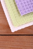 Colorful napkins on wooden table