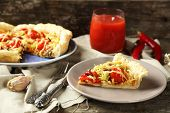 Vegetable pie with paprika, tomatoes and cheese on plate, on wooden background