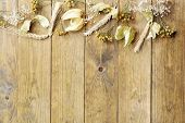 Dried wheat on rustic wooden planks background
