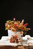 Dried flowers in pot on dark background