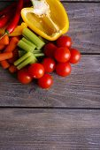 Fresh vegetables on rustic wooden planks background