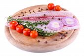 foto of pangasius  - Pangasius fillet on wooden cutting board with cherry tomatoes and spices isolated on white - JPG