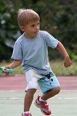 boy catching tennis ball
