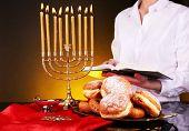 Festive ceremony on Hanukkah on dark background