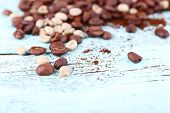 Coffee beans on light blue wooden background