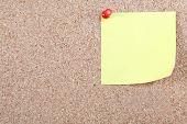 Blank Yellow Note Pinned To Corkboard