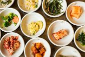 pic of kimchi  - Top view of variety of Korean food including Kimchi - JPG