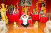 Young  Woman Praying And Meditating Buddha Near Temple, Thailand, Phuket