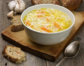 image of noodles  - noodle soup in a cup on a wooden background - JPG