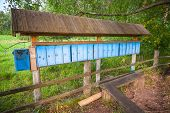 stock photo of mailbox  - Old blue mailboxes in a row small Russian village - JPG
