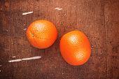 picture of bittersweet  - Fresh Ripe Tropical Sweet Orange Fruit on Rustic Grunge Brown Wood Background Top View  - JPG
