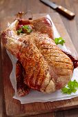 picture of roast duck  - Whole roasted duck on a wooden table - JPG