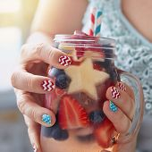 stock photo of independent woman  - Patriotic drink cocktail with strawberry - JPG