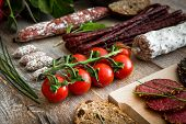 picture of salami  - A bunch of cherry tomatoes with salami sausages - JPG