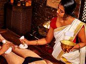 pic of panchakarma  - Young woman having indian feet Ayurveda spa massage - JPG