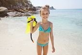 stock photo of preteen  - Preteen child posing with snorkeling equipment on a tropical beach - JPG