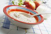 picture of porridge  - Porridge and red apples on a wooden table - JPG