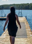 image of pier a lake  - Young Woman walk on the Pier in the Lake - JPG