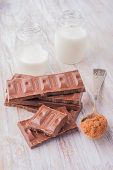 pic of milk  - Milk chocolate cocoa and milk bottle on white wooden table - JPG