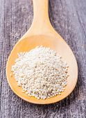 picture of sesame seed  - Sesame seeds on a wooden spoon on old wooden table - JPG
