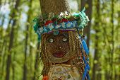 stock photo of pagan  - The pagan idol in the spring woods - JPG