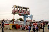 image of carnival ride  - RUSTENBURG SOUTH AFRICA - MAY 25: Black African families enjoying electronic rocker rides at Rustenburg Fair on May 25 2014 in Rustenburg South Africa.