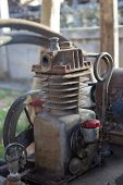 picture of air pressure gauge  - Rusty air compressor (belt drive), part of air compressor ** Note: Shallow depth of field - JPG
