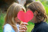 Couple Holdin Heart