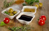 picture of vinegar  - Dressing ingredients on a wooden background - JPG
