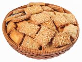 foto of sesame seed  - Cookies with sesame seeds in a wicker bowl on a white background - JPG
