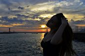 image of humility  - summer beautiful girl at sunset on the sea - JPG