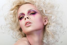 foto of clowns  - Portrait of young sensual woman with blond curly hair and fashion clown make - JPG