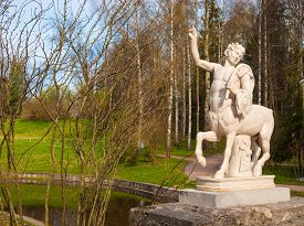 stock photo of centaur  - Ancient Centaur Sculpture on the bridge in Pavlovsk park - JPG