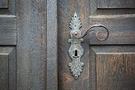 image of door-handle  - old wooden entrance door with antique door handle - JPG