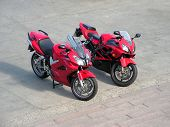 Two Red Beautiful Motorcycles .
