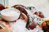 Постер, плакат: Fish on ice on market store shop Dorado fish on ice healthy f