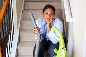 stock photo of cleaning house  - Woman cleaning in her house with a vacuum cleaner - JPG